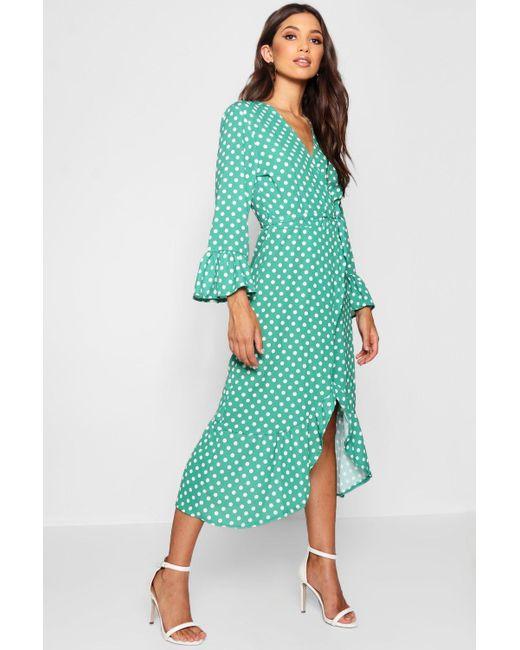 8770e02b2902 Boohoo - Green Wrap Front Polka Dot Ruffle Hem Midi Dress - Lyst ...
