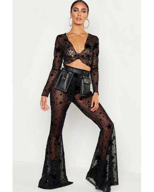 f9266fd36320 Boohoo - Black Flock Mesh Star Print Flare Trouser - Lyst ...
