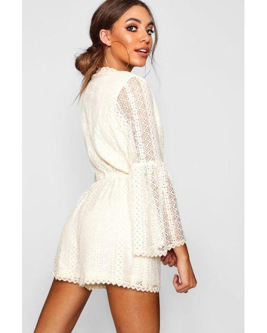 056c5dd4ae4 ... Boohoo - White Flare Sleeve Crochet Playsuit - Lyst
