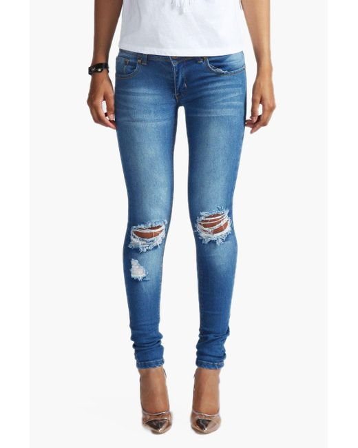 34bc9c479fa Boohoo Mid Rise Distressed Rip Knee Skinny Jeans in Blue - Save 40 ...