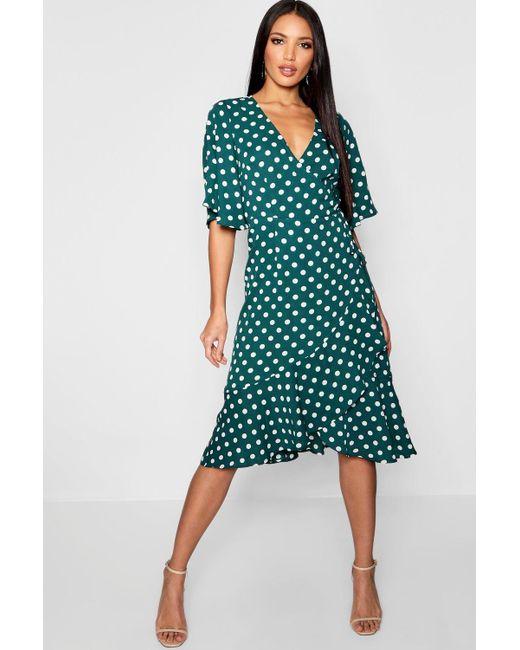 5961f0202aa0 Boohoo - Green Wrap Front Ruffle Hem Polka Dot Midi Dress - Lyst ...