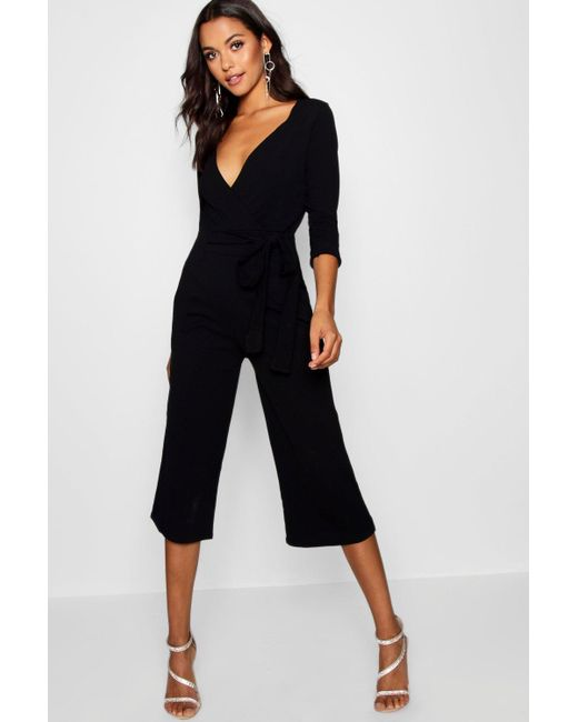 e63ce04d0f2 Boohoo - Black Roll Sleeve Relaxed Culotte Jumpsuit - Lyst ...