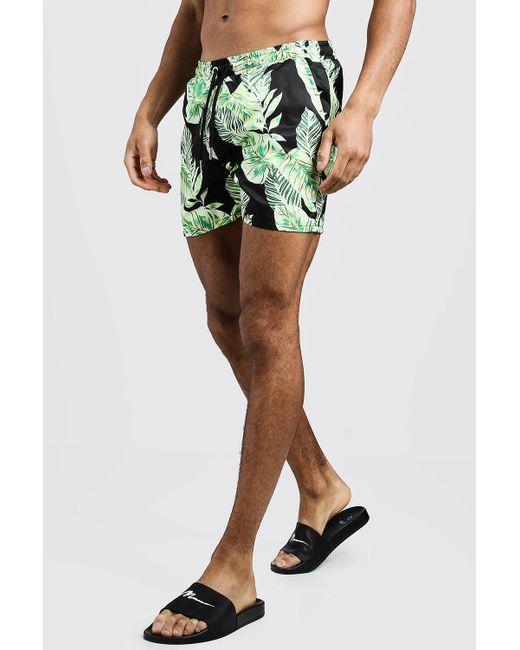 b43f339548 BoohooMAN - Black Palm Print Mid Length Swim Short for Men - Lyst ...
