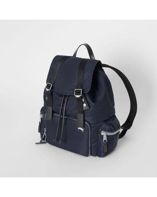 589d3cdde960 ... Burberry - Blue Leather-trimmed Nylon Backpack for Men - Lyst ...