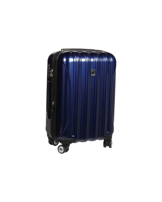 delsey helium aero 21 carry on expandable spinner trolley in blue lyst. Black Bedroom Furniture Sets. Home Design Ideas