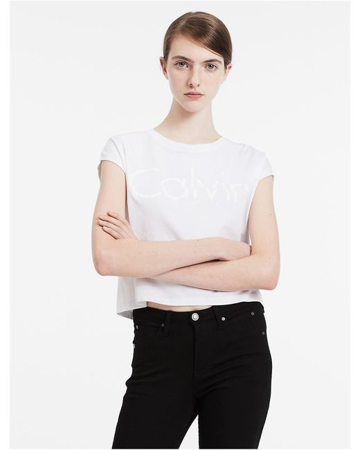 Calvin Klein | White Jeans Cap Sleeve Cropped Logo T-shirt | Lyst