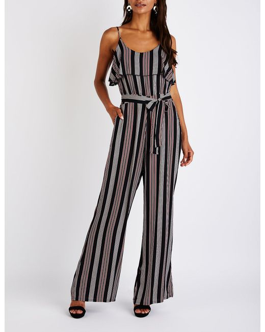 8fdf206acc7 Charlotte Russe - Black Printed Ruffle Trim Jumpsuit - Lyst ...