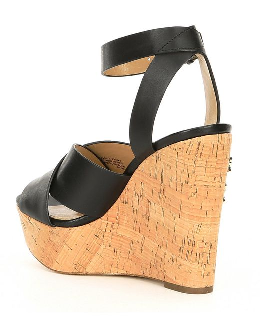 84c684ad746 ... MICHAEL Michael Kors - Black Lacey Leather   Butterfly Charm Cork Wedge  Sandals - Lyst