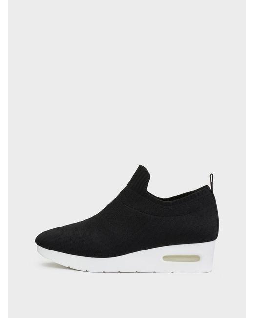 DKNY - Black Angie Slip On Low Wedge Sneaker - Lyst