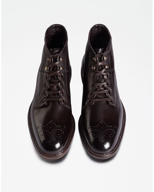 dolce gabbana colored dip coated leather boots in black