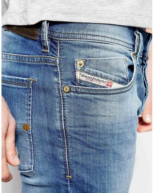 diesel jeans sleenker 607k skinny fit stretch light distressed wash in blue for men. Black Bedroom Furniture Sets. Home Design Ideas