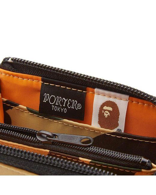 49bf32bedda ... A Bathing Ape - Yellow X Porter 1st Camo Mini Wallet for Men - Lyst ...