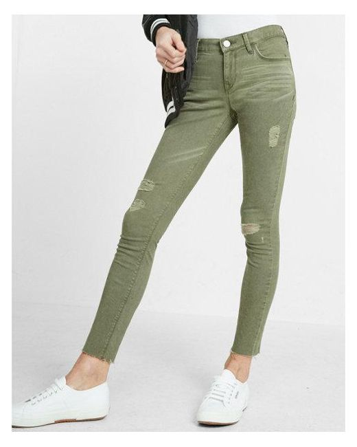 2a788e6b9790f Lyst - Express Mid Rise Raw Hem Five Pocket Ankle Legging in Green ...