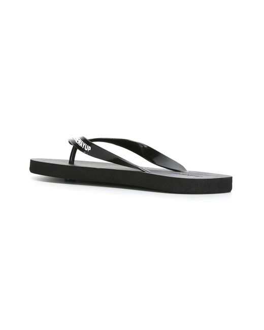 philipp plein embossed logo flip flops in black for men lyst. Black Bedroom Furniture Sets. Home Design Ideas
