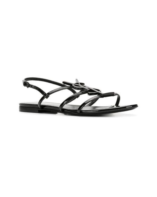 c4f6998939f2 Lyst - Saint Laurent Cassandra Leather Flat Sandals in Black - Save 24%