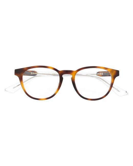 8046fe4997 Lyst - Gafas con montura oval Gucci de hombre de color Marrón