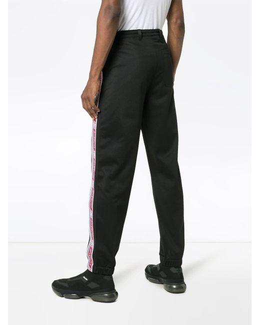 1598eb1dc58 ... Givenchy - Black Pantalon de jogging à bandes logo for Men - Lyst