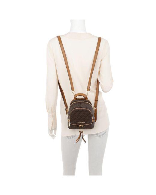 9af032575273 ... ireland michael kors rhea zip xs messenger backpack brown lyst 49322  04468
