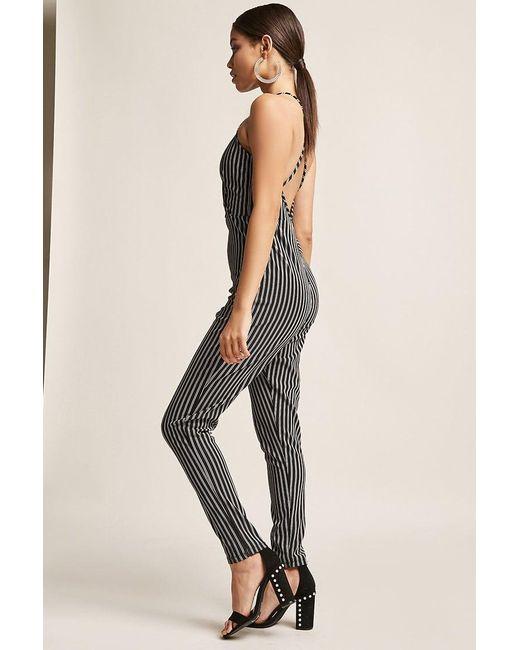 5d464de490b ... Forever 21 - Black Stripe Surplice Jumpsuit - Lyst