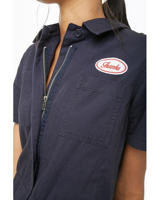 1ba37c549c9 ... Forever 21 - Blue Patch Graphic Zip-front Utility Jumpsuit - Lyst