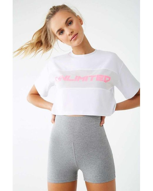 6288e5fddf3a6 Forever 21 - White Active Unlimited Graphic Crop Top - Lyst ...