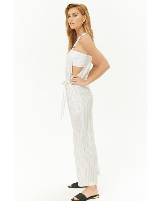 806aa55dd77c ... Forever 21 - White Pinstriped Drawstring Overalls - Lyst