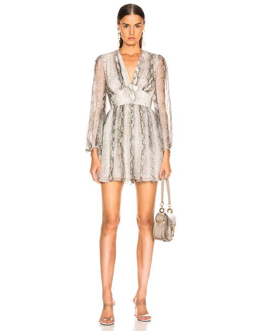 04cd705f556 Zimmermann - Natural Corsage Fluted Playsuit - Lyst ...