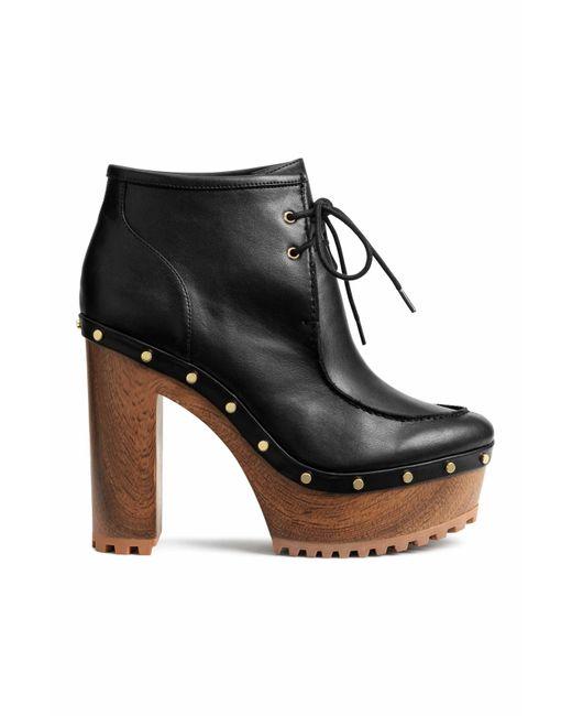 h m platform boots in black lyst