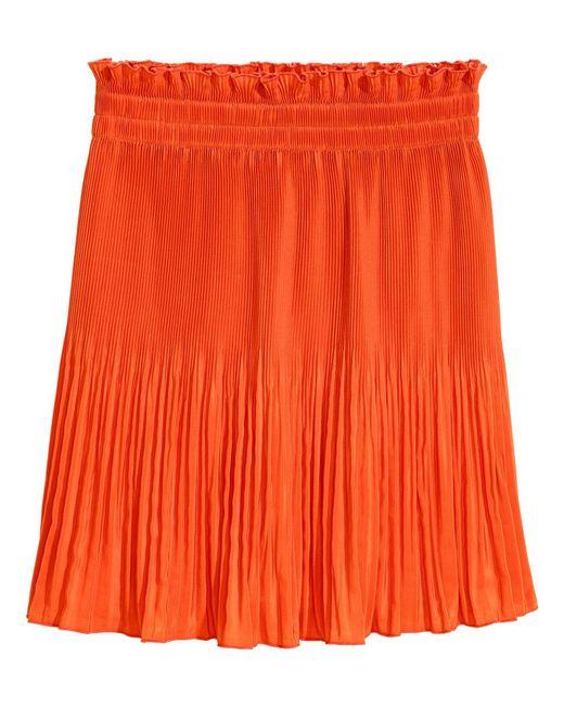 h m pleated skirt in orange lyst