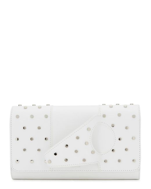 a4f141e1a1eafa Lyst - PERRIN Paris L'asymetrique Studded Leather Clutch in White ...