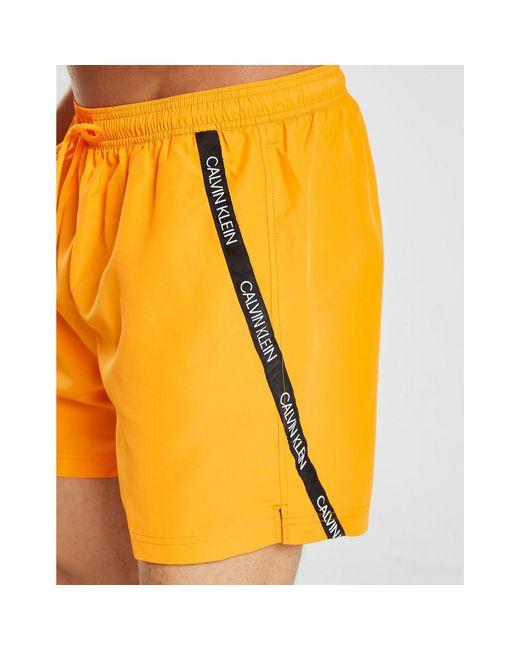 49640243292 ... Calvin Klein - Orange Medium Drawstring Swim Trunks for Men - Lyst ...