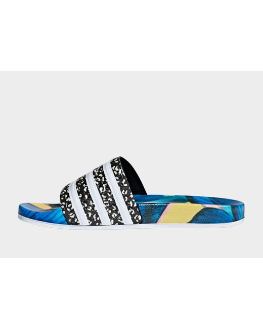 new style f3a20 5b9bf Adidas - Blue Adilette Slides - Lyst ...