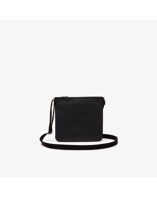 e2ca948adf1881 Lacoste - Black Classic Coated Piqué Canvas Flat Crossover Bag - Lyst ...