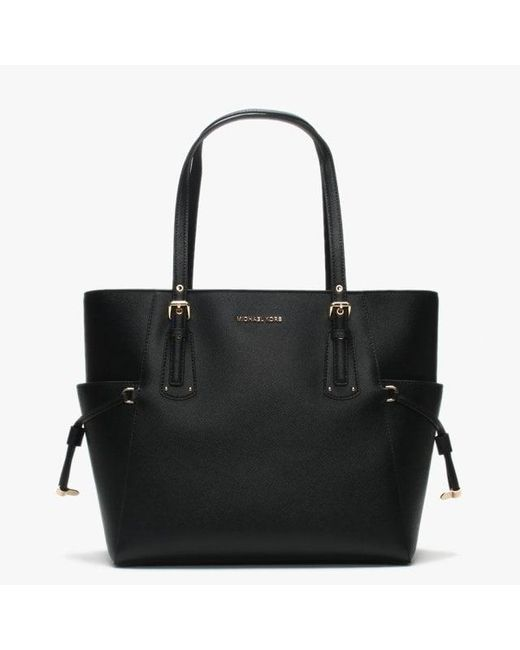 672adb64969b Michael Kors - Voyager East West Black Saffiano Leather Tote Bag - Lyst ...