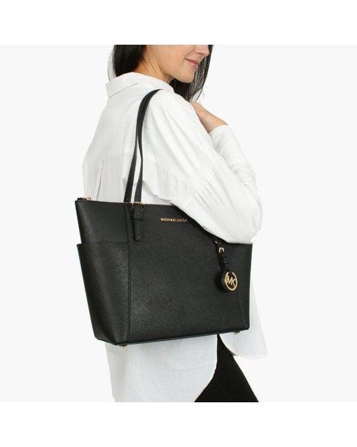 ... Michael Kors - Jet Set Pocket Black Leather Top Zip Tote Bag - Lyst ... 2fd9078c4baa2
