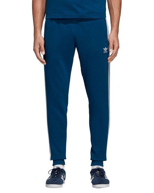 457f4e6b8 Adidas - Blue Adicolor Three-striped Logo Fleece Sweatpants for Men - Lyst  ...
