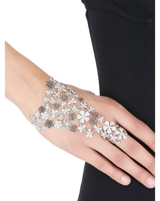 Colette | Black Flower Hand Bracelet | Lyst