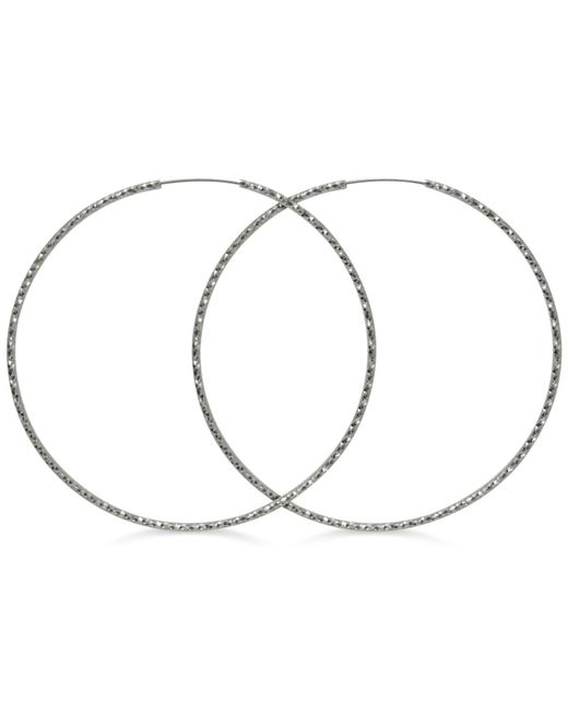 Guess - Metallic Textured Extra-large Hoop Earrings - Lyst
