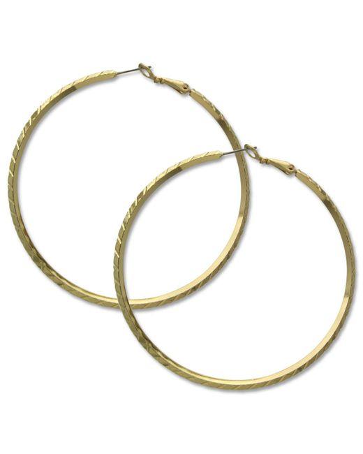 Guess | Metallic Earrings, Gold-tone Clutchless Textured Hoop Earrings | Lyst