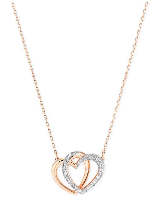 Swarovski - Pink Rose Gold-tone Crystal Pavé Interlocking Double Heart Bangle Bracelet - Lyst