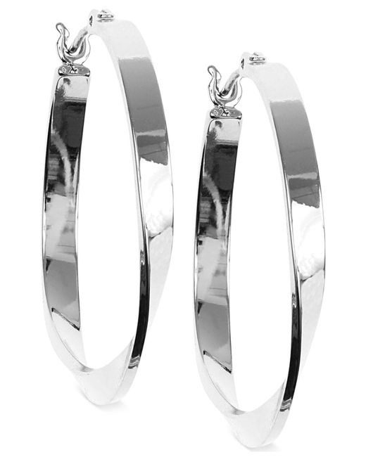 Nine West - Metallic Twisted Hoop Earrings - Lyst