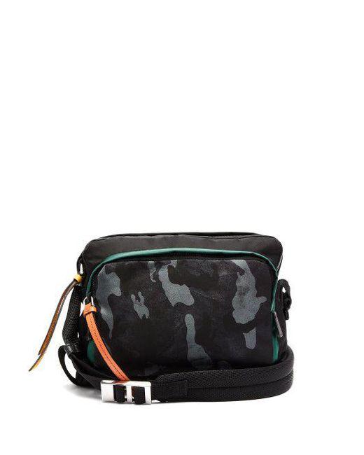 5c144e8bda0b34 ... canada prada black camouflage print nylon shoulder bag lyst 35153 56590