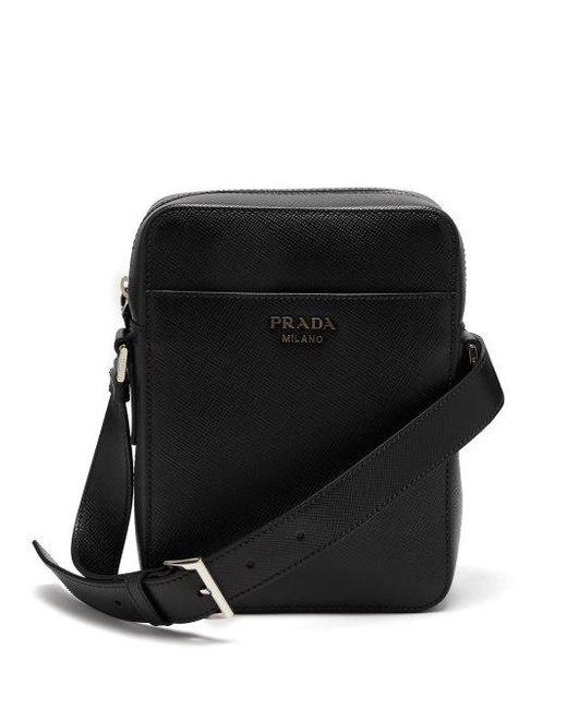 fd3227c021c1 ... italy prada black logo embellished saffiano leather camera bag for men  lyst 55b51 9378b