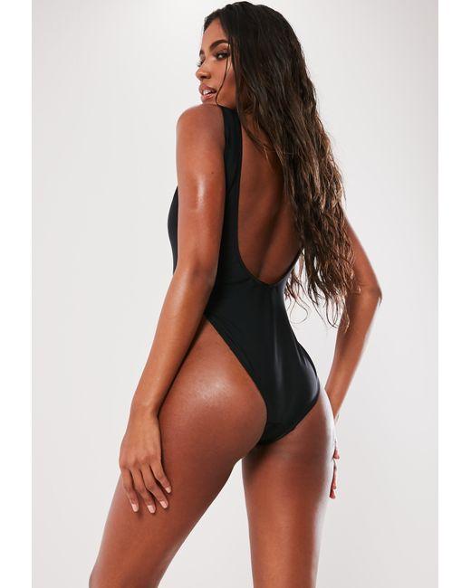 c440733b829 ... Missguided - Black Plunge High Leg Swimsuit - Lyst ...