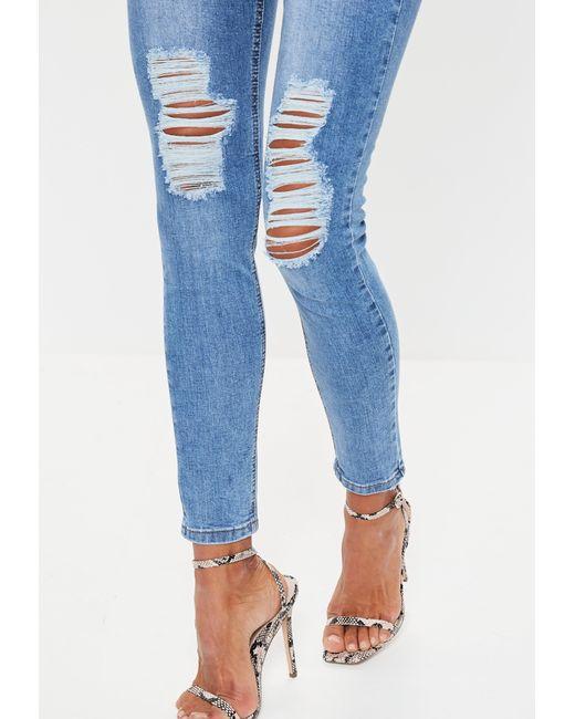7fd88848 Lyst - Missguided Blue Sinner Distress Knee High Waist Skinny Jeans ...