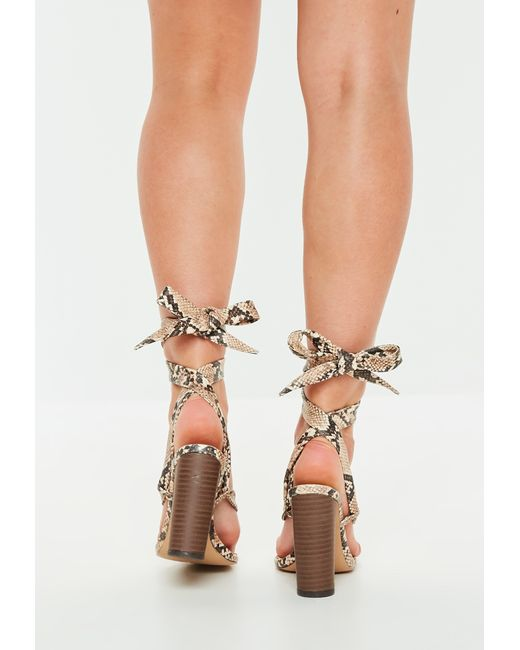 1b09a75608c ... Missguided - Natural Nude Snake Print Wrap Block Heel Sandals - Lyst ...