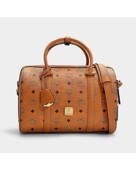 MCM - Brown Essential Visetos Goldiginal Boston Medium Bag In Cognac Pvc - Lyst