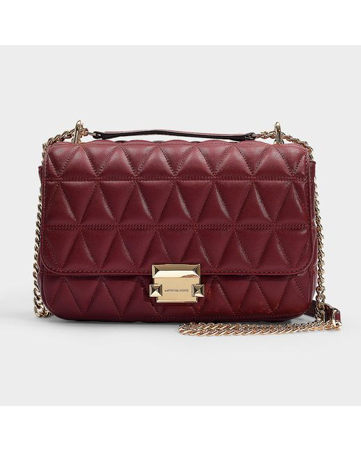 0318fefc8c41 MICHAEL Michael Kors - Multicolor Sloan Large Chain Shoulder Bag In  Burgundy Quilted Lambskin - Lyst ...