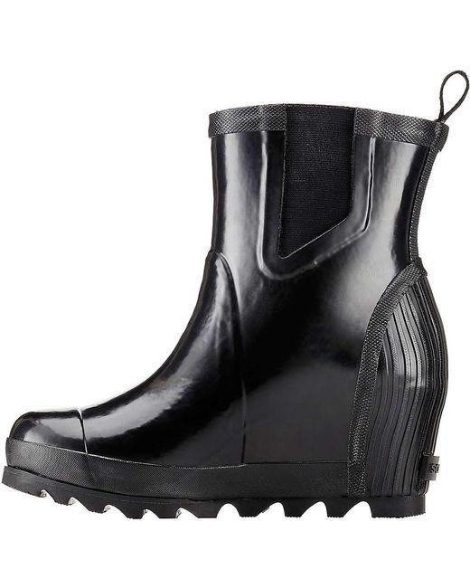 66adc446f8b2 ... Sorel - Black Joan Rain Wedge Chelsea Gloss Boot - Lyst ...