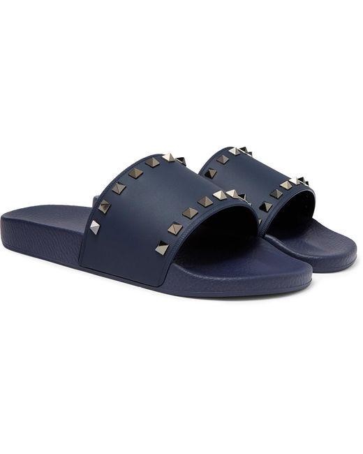 70eab7f4710 Valentino Garavani Rockstud Rubber Slides in Blue for Men - Save 50 ...